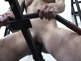 Redhead Female Bodybuilder Masturbates with Gym Equipment